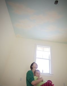 Author/illustrator @Grace Lin shares tips and paint recommendations for adding a beautiful cloudscape to the ceiling of a nursery (or other room!)  #baby #mural