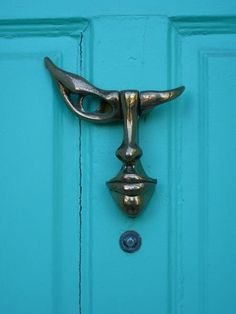 Lucid Mirage with a Silver knocker on a Coral Blue Door