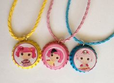 """This listing is for (12) Lalaloopsy Bottle Cap Necklaces on a 18"""" to 24"""" leather breathed necklaces sealed with 3D epoxy dome stickers.     These bottle cap necklaces are the perfect addition to your Girl Gaming Birthday party! They  are also available as a zipper pull or a keychains as well.    ..."""