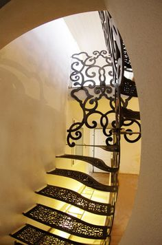 """""""Bologna.Staircase"""" designed by LauroGhediniStudio. Made with metal parts derived from laser cutting, water cutting with solid portions of milling, turning The steps are made of steel having a great modulus of elasticity. Painted transparent with high strength by expert craftsman applicator"""