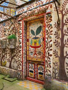 painted wall- funky, eccentric garden wall- great for a hidden spot in the garden