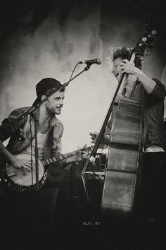 Winston Marshall and Ted Dwane of Mumford & Sons perform at Pinkpop on May 28, 2012.