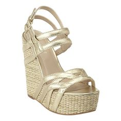 """As seen in the March issue of Lucky magazine.....Woven wedge sandal with strap detailing.  Adjustable buckle closure.  Measures: wedge 5.5"""" and platform 2""""."""