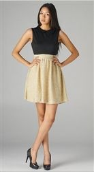 Black and gold cocktail dress, perfect for a winter wedding