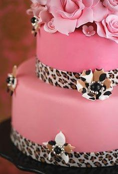 Leopard print cake with pink flowers.