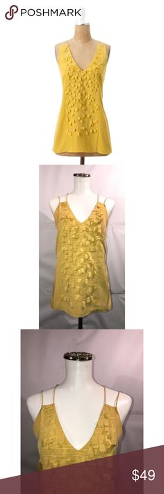 "Sachin + Babi Sz 2 Anthro Yellow Origami Tank NWOT Sachin + Babi Sz 2 Anthro Yellow Origami Tank NWOT🔸Size 2 🔸High quality designer from Anthropologie🔸100% polyester🔸Lined🔸 Gentle dry clean🔸Length is approximately 23.5""🔸Bust 32-34🔸Zip closure on the side🔸Fun square fringe on the front with embroidery🔸Spaghetti strap racer back🔸NWOT🔸Retails for $228.00 Anthropologie Tops Blouses"