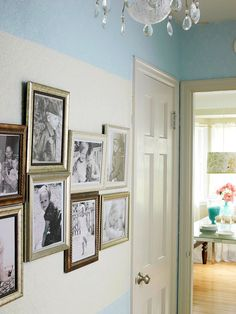 Hallway walls are a perfect spot to create a family photo gallery. Use different sizes and textures for frames and try hanging the photos at different levels. The eclectic arrangement provides lots of visual interest.