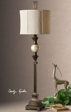This beautiful buffet lamp features a hand rubbed dark bronze finish accented with a lightly stained capiz shell ball. The round modified drum shade is a khaki Bronze Floor Lamp, Buffet Lamps, Table Lamps, Tuscan Decorating, Glamour, Drum Shade, Accent Furniture, Contemporary Furniture, Home Accents