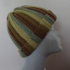 Handmade crochet ribbed beanie Colours: Mixed brown, green, cream Height: 24 cm Circumference: 54 cm Material: 100% Acrylic Aftercare: 40°C wash, dry flat, do not tumble dry, do not iron