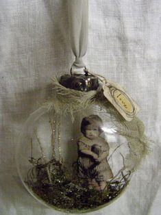 Make a Family Heirloom Ornament - put tinsel and a tiny photo of your special someone into a clear ornament.