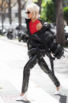 Vanessa Hong seen wearing a black Moncler jacker in the streets of Paris after the Moncler show during the Paris Fashion Week Womenswear...
