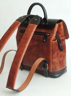 Купить или заказать Рюкзак в интернет-магазине на Ярмарке Мастеров. Небольшой рюкзак из комбинации натуральной кожи двух цветов -чёрной и коньяк с эффектом потёртости..Регулируемое положение клапана рюкзака.Мягкие наплечники.Возможно исполнение в другом сочетании цветов.