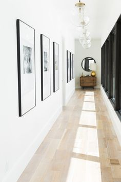 Do you to make your long narrow entryway or hallway appear bigger? These narrow entryway ideas will help your entryway make a strong first impression. Hallway Wall Decor, Hallway Walls, Upstairs Hallway, Hallway Lighting, Entry Hallway, Hall Way Decor, Hallway Wall Lights, Hallway Ideas Entrance Narrow, Hallway Decorations