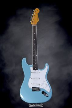 Fender Eric Johnson signature stratocaster in Tropical Turquoise with a rosewood fretboard - I love the binding along the fretboard on these.