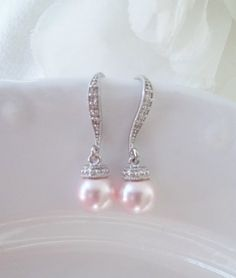 ~ALLEE~      This pair of charismatic earrings feature elegant Swarovski 8mm Platinum pearls adorned by silver bead caps. Dangling from silver