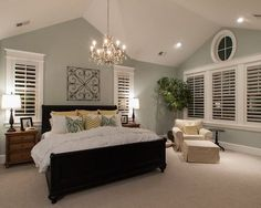 The ultimate master bedroom in the eyes of Pinners has a chandelier and even a chair by the window to curl up in.