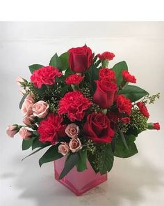 A Beautiful progression of color in this pink cube arrangement called Shades of Love. Found only at Moles Flower & Gift Shop, this arrangement includes pink spray roses, hot pink carnations, red roses and red miniature carnations.