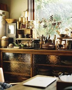 On the cupboard, arrange the items you use all the time. Bright light is inserted through the window, and the dishes are going to be happy, too.