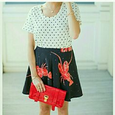 "Playful Lobster Skirt NWT **more sizes** Go down by the Bay in this Lobster skirt!! So fun & playful, this skirt features lobsters on a black background with gray polka-dots.   Dress this skirt up with a polka-dot top & heels or make it causal with a t-shirt, demin jacket & statement sneakers. You can even pair it will fun leggins' & booties. This will be one of your favorite skirts!   Brand new w/tag  100%polyester  Length approx 16""  Waist seam to seam almost 15.5""  Size 6  Designer Viva…"