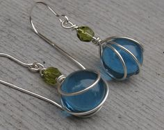 Little Teal Glass Marbles with Olive Green Wirewrapped Earrings. $16.50, via Etsy.