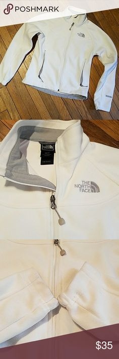 The North Face fleece Windwall jacket XS The North Face fleece Windwall jacket XS ivory white in excellent condition. Light weight wind breaker fleece. Only signs of wear at inner wrist cuffs discoloration. The North Face Jackets & Coats