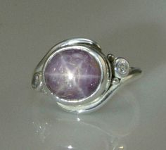 Sterling Silver Star Ruby and Moissanite- One of a Kind. $330.00, via Etsy.