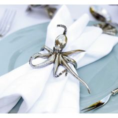 Vagabond House's delightful pewter Octopus Napkin Rings are delicately detailed; the octopi have curled tentacles with realistic suckers, beautifully pebbled s…