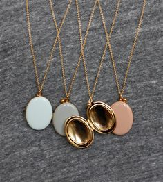 Enamel lockets at Alder and Co. Love the clean elegance
