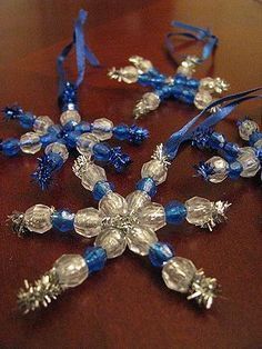 Craft idea for Charlie's holiday party at school- silver pipe cleaners with clear and blue beads