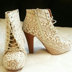 """Lace booties Go vintage-chic with this heeled ankle boot! Vegan-leather upper features a vintage-style lace overlay and includes a lace-up front. 5.5"""" zipper gets you in and out fast. Featuring a hidden 1.25"""" platform and 4.5"""" heel in faux wood.?Got them as a gift but I wear a size 10w. Had my friend try them on she said they were really comfy, i did as well just tight for me. Love this booties alot! Only if they fit me I would have kept it! Brand new never worn! Charlotte Russe Shoes Ankle…"""
