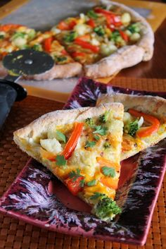 If you like pizza night, fall flavors, and curry then this pizza is for you. My favorite Greek yogurt crust is topped with pumpkin curry sauce, two cheeses and lots of veggies.