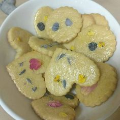Edible flowers from Floating Petals Confetti on shortbread cookies by mirwills1 on Etsy.