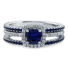 This 3-piece halo ring set exudes luxury. Its simplicity will complement every woman's elegance. Made of rhodium plated fine 925 sterling silver. Bands measure 4.5mm in width. Features 0.46 carat cushion cut simulated blue sapphire cubic zirconia (5mm) in 4-prong setting. Accented with 0.86 ct.tw round cut clear and round cut simulated blue sapphire cubic zirconia in micro pave setting. Nickel free.