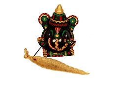An exquisite design of Ganeshji, in terracota, handcrafted and painted in multi colours to give that elegant look. This art will usher in an auspicous environment into your home. The Incense Stick Holder is in exquisite golden paint , and designed to collect the ashes of the incense stick. The combination of these two items are indeed personified form of pious beauty.