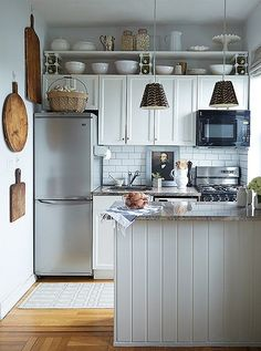 Beautifully organized rustic gray kitchen.