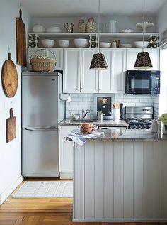 Beautifully organized rustic gray kitchen.