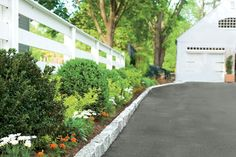 How to Install Belgian Block Driveway Edging Edge Your Driveway - I'd love to this along ours (if only our blacktop looked as nice!) It'd be nice to eliminate any grass between the driveway and house. Landscape Edging, Garden Edging, Landscape Designs, Garden Borders, Driveway Landscaping, Driveway Ideas, Landscaping Ideas, Driveway Pavers, Stone Driveway