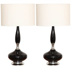 Pair Of Black Ceramic And Chrome Lamps c. 1960's | From a unique collection of antique and modern table lamps at http://www.1stdibs.com/furniture/lighting/table-lamps/
