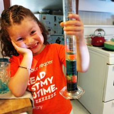 """She was pretty excited about making her density column! It definitely helped her realize that some liquids are heavier than others, and then, of course, it became """"let's put EVERYTHING in it!!!"""" Gotta love first grade scientists! #stemgirls #girlsinscience #density #scienceexperiment #learningtogether"""