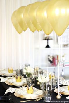 A dinner party table setting with balloons will wow your guests with an unexpected focal point, perfect for Christmas or New Years Eve parties.
