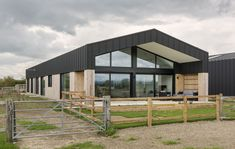 An award-winning Class Q permitted development project consisting of the conversion of two tired steel and concrete framed barns near Long Crendon in Buckinghamshire into modern, energy-efficient family homes. Barn Conversion Exterior, Barn House Conversion, Barn Conversions, Metal Building Homes, Building Design, Building A House, Steel Structure Buildings, Metal Buildings, Converted Barn Homes