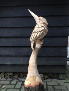 Chainsaw carving kingfisher