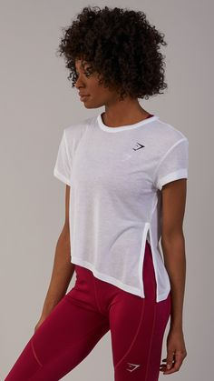 Designed as your core, versatile workout t-shirt, the Women's Essential Tee has cool turned up sleeves and offers the choice to tie into a crop. Coming soon in White.