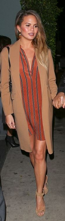 Who made Chrissy Teigen's orange stripe dress and nude sandals?