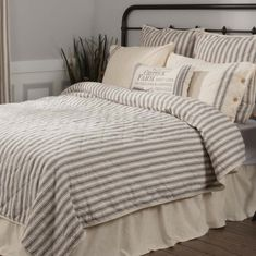 """King size, 95""""L x """"105""""W 100# cotton shell and batting Grey and cream ticking stripe fabric reverses to solid cream Hand-quilted with on-point quilt design"""