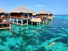 Coco Bodu Hithi Bodu Hithi Island, Maldives Island Luxury Overwater Bungalow Romance Romantic Waterfront sky water Sea Ocean Beach swimming pool caribbean shore Nature Lagoon Coast Resort cape vehicle cove blue swimming day