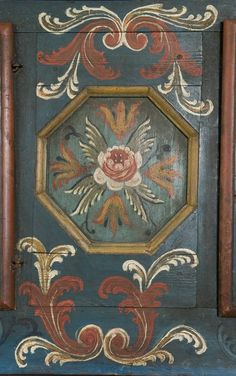 Closeup of painted Norwegian folk art cabinet, marked with the year 1797. From Telemark, Norway.