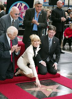 Tender moments from Celine Dion and René Angelil's 21-year marriage -  Celine was honoured with a star on the Hollywood Walk of Fame in 2004, with her proud husband René cheering her on at the ceremony.