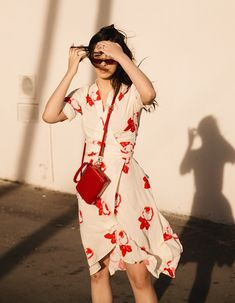 red and white floral Ganni dress and mini red box bag