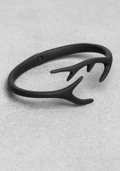 Edgy and feminine, this bracelet features horn-looking ends.